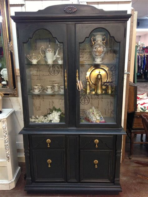 black chalk paint china cabinet with blue gray interior