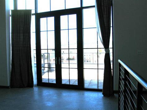 loft window curtains living in a fish bowl or floor to ceiling windows and
