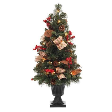 christmas tree with berries 32 in pine potted artificial tree with pinecones berries and burlap