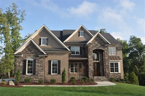 house with brick and siding exterior with stone brick and siding use hardiplank instead of siding