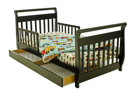 toddler beds with storage dream on me sleigh toddler bed with storage drawer in