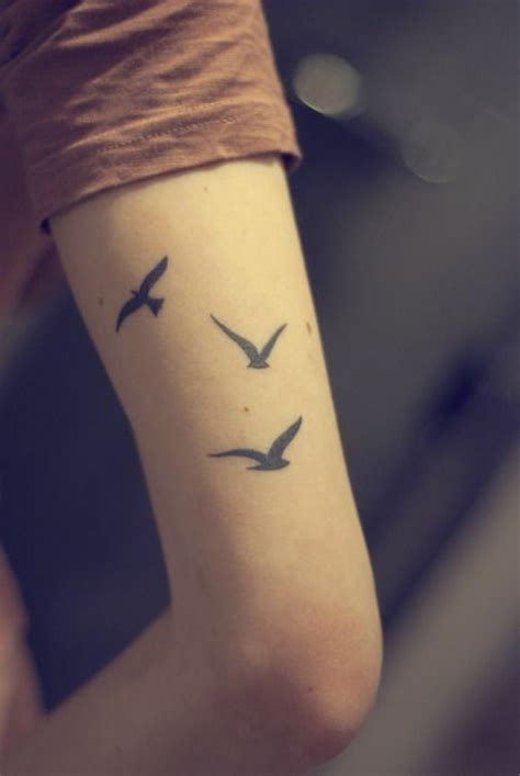 bird tattoo on arm designs 110 upper arm of tattoo designs exles for a new look