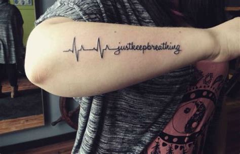 keep going tattoo 22 photos of inspiring heartbeat tattoos