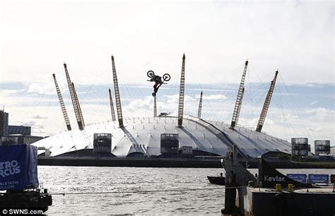 River Thames Jump Stunt | stunt motorcyclist jumps between two river thames barges