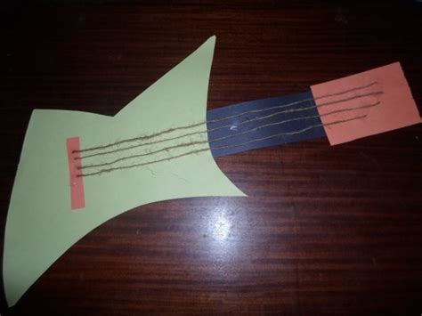 How To Make A Guitar With Paper - paper guitar craft activity paper guitar image 7