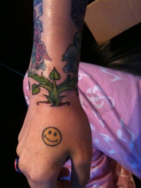 cassadee pope smiley face back of hand tattoo steal her