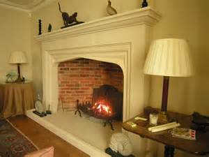 large bespoke jacobean arched stone fireplace