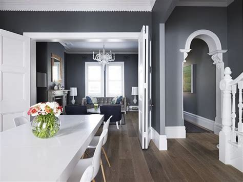 dark gray walls love the grey walls white trim with the dark wood floors living room greg natale s payne house