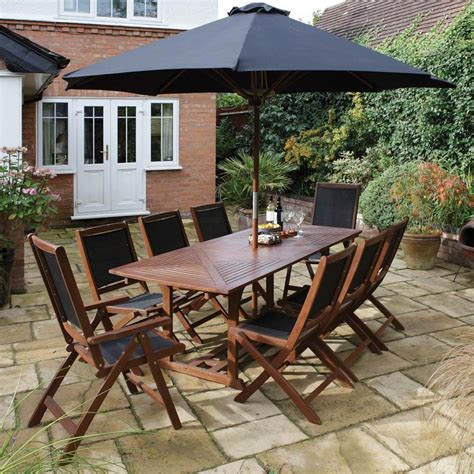 garden table and chairs set 10 hardwood table chair parasol garden dining set
