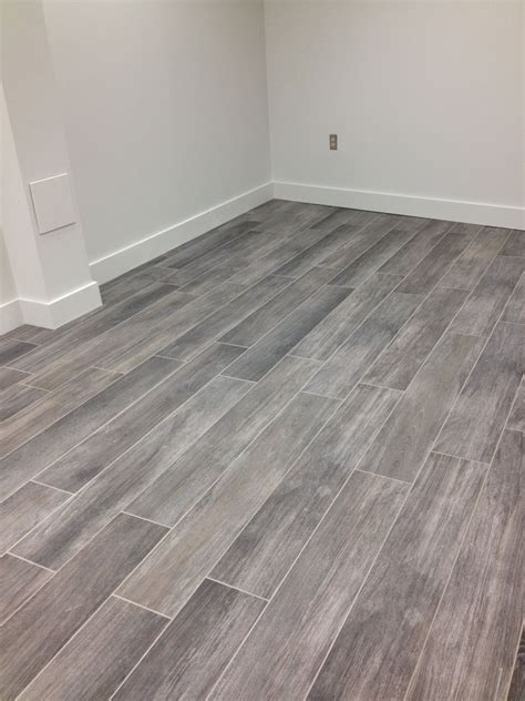 tiling on wooden floors bathroom gray wood tile floor no3lcd6n8 homes pinterest wood