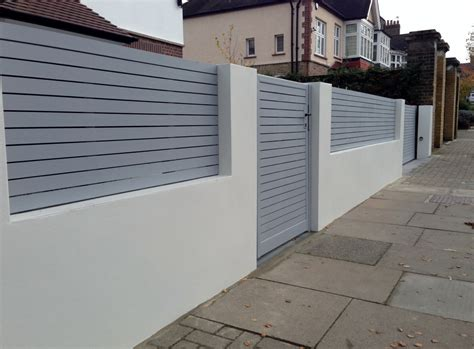 front boundary wall screen automated electronic gate installation grey wooden fence bike store