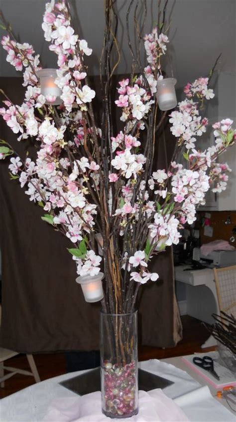 cherry blossom and curly will centerpiece with handing