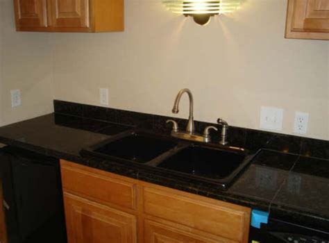 black countertop with black sink 49 best images about bitchen kitchen on black