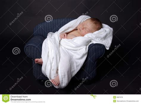 sleeping on sofa with newborn newborn baby on royalty free stock photos image