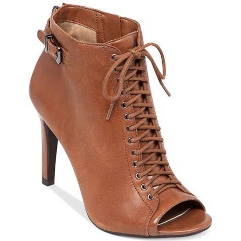 erlene lace up booties in brown lyst