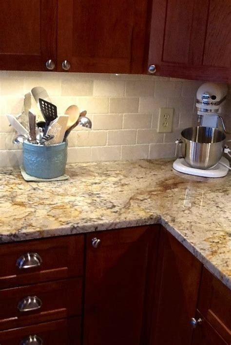 beige kitchen cabinets with typhoon bordeaux granite backsplash help to go w typhoon bordeaux granite