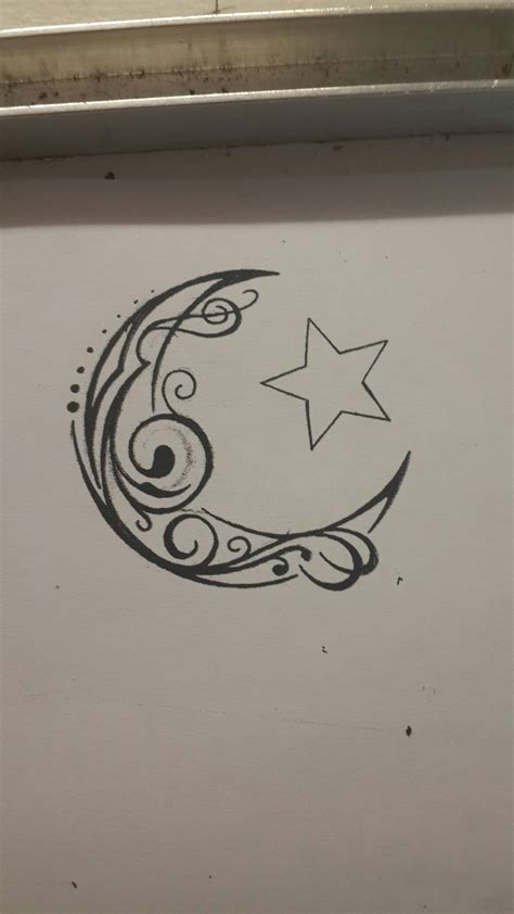 tribal with stars tattoo crescent moon and tribal swirl design
