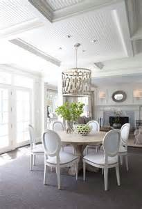white and gray dining room with worlds away leona silver