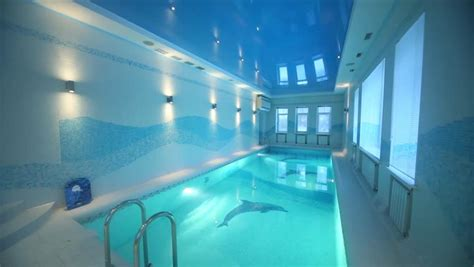 turning lights in indoor pool with clear water in big