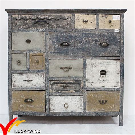 shabby vintage chic wooden cabinets with many drawers