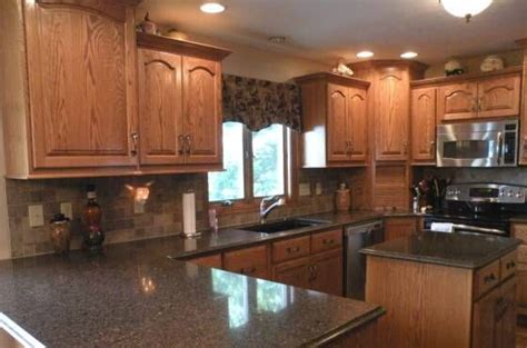 kitchen colors with oak cabinets and black countertops honey oak kitchen cabinets with black countertops top of