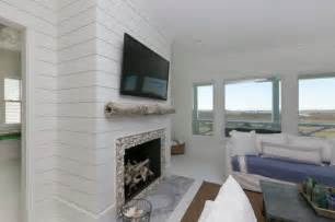 White island white living room with wooden shiplap walls fireplace