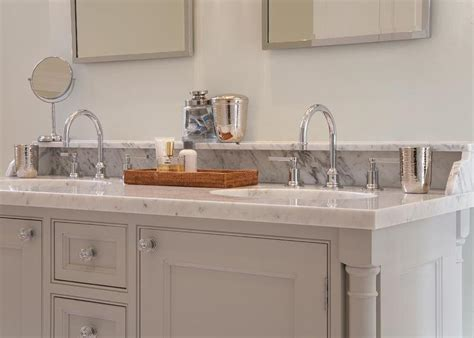 gray bathroom vanity with marble backsplash shelf