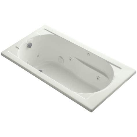 What Is A Reversible Drain Bathtub by Kohler Devonshire 5 Ft Acrylic Reversible Drain