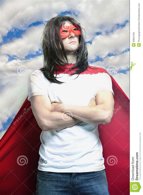 costume with arms in costume with arms crossed against cloudy sky royalty free