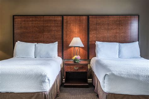 bedroom with sofa bed 2 bedroom suite bedroom 1 two doubles bedroom 2 queen