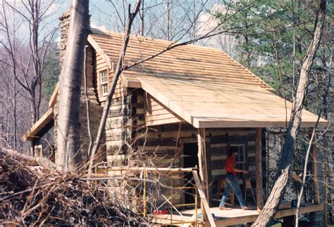 Handmade Log Cabin - a cedar shake roof on a log cabin handmade houses