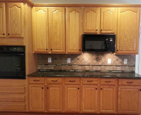 honey oak cabinets with verde butterfly countertops