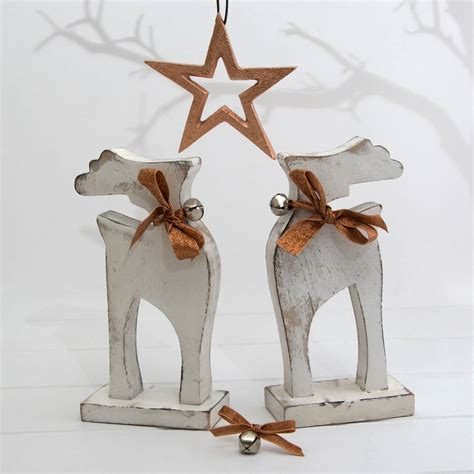 white wooden christmas reindeer ornament by twenty six
