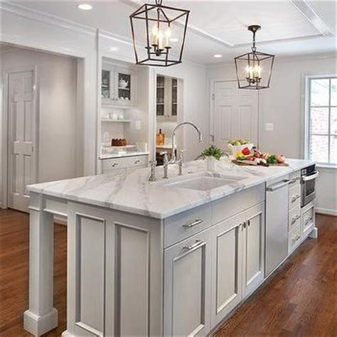 Long Gray Kitchen Island with Gray Upholstered Backless