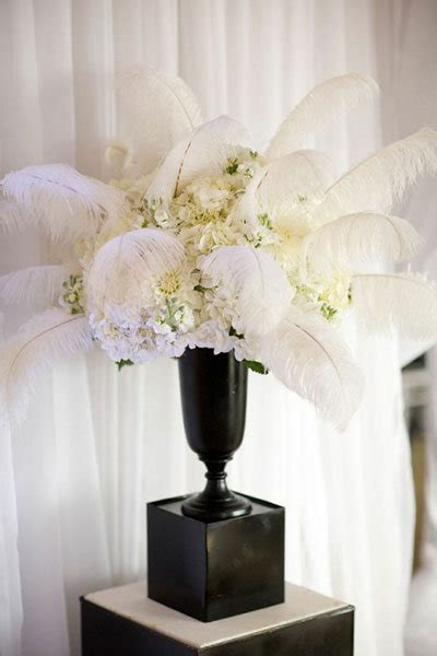 centerpieces with feathers and flowers wedding ideas by decade bridalguide