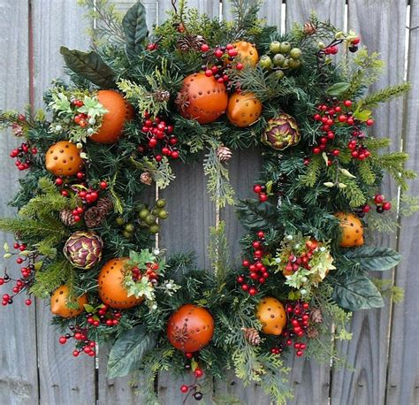 christmas decorations with berries wreath williamsburg style wreath with fruit artichokes and
