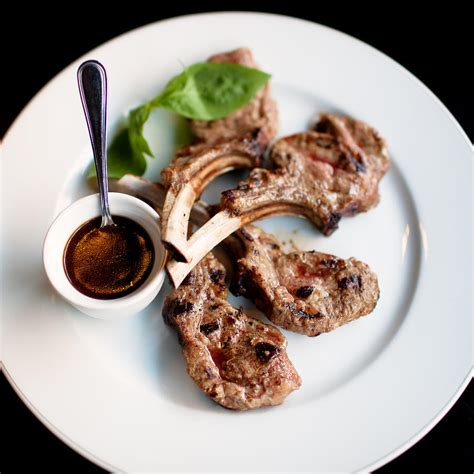 Grilled Rack Of Rosemary by Grilled Rack Of Served In A Plate With Rosemary Sauce