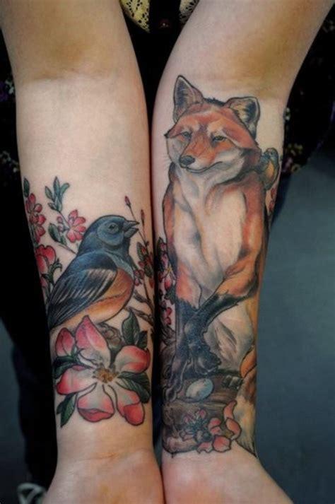 bird tattoo on arm designs bird flower n wolf tattoo on arms tattooshunt com