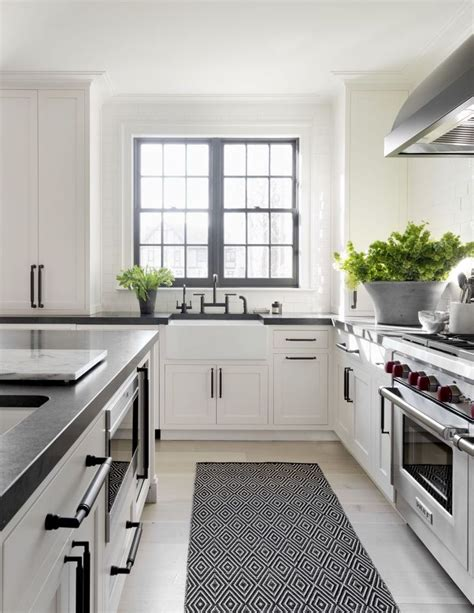 kitchens with white cabinets and black countertops and black kitchen designs black and white kitchen