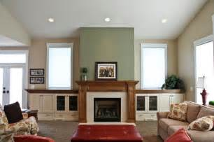 fireplace in family room with built ins windows