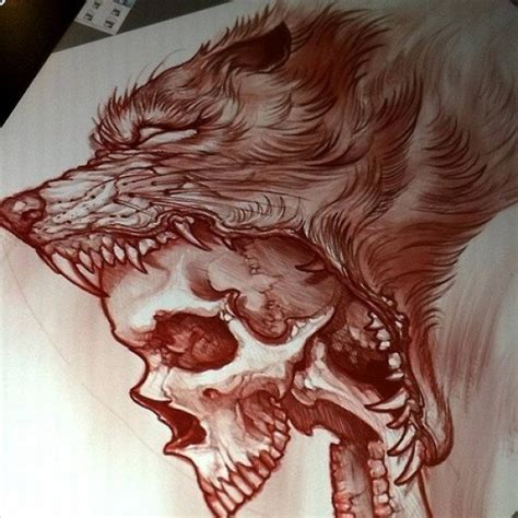 insant wolf eating a skull tattoo design tattooimages biz