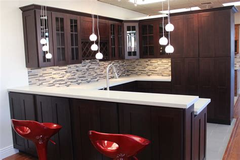 gray countertops with brown cabinets dark brown wooden kitchen cabinet and island with white