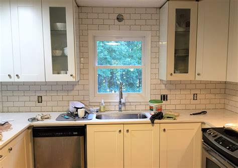 subway tile backsplash step by step tutorial part one hometalk subway tile step by step tutorial part two and grout