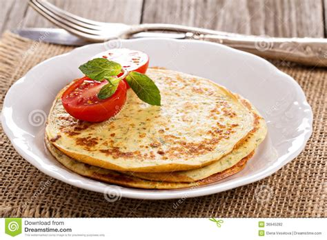 savory pancakes with tomatoes stock photography image