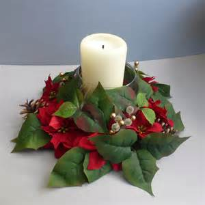 christmas wreath candle ring with artificial ponsettias