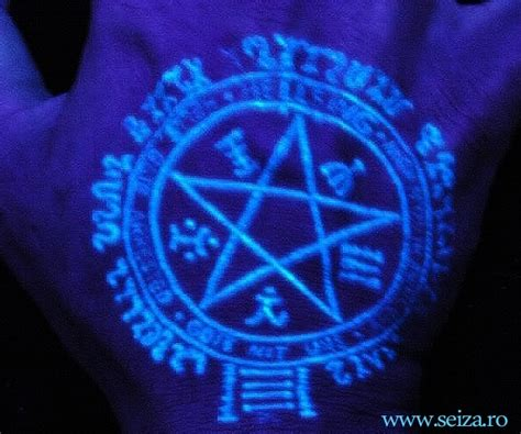 fluorescent tattoo pentagram made with uv reactive ink black light