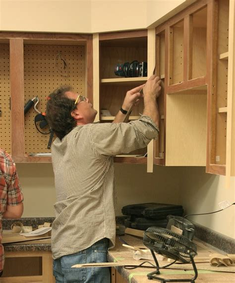 learn how to reface cabinets with peel stick veneers