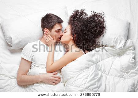 images of love kiss in bed kiss curl stock images royalty free images vectors