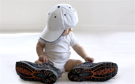 the with the shoes baby with big shoes and baseball cap