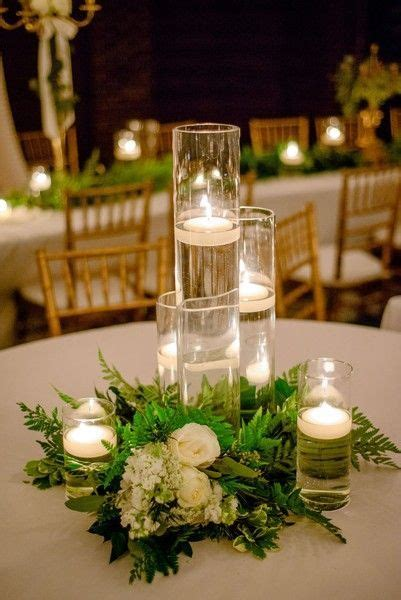 trendy greenery wedding centerpieces  candles